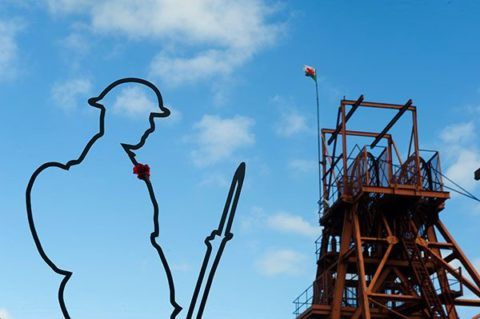 There But Not There silhouette of a Tommy against a blue sky at Big Pit
