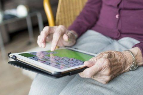 elderly person on ipad