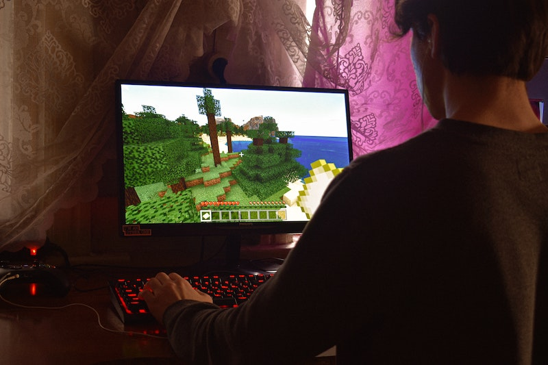 Person plays Minecraft on computer.